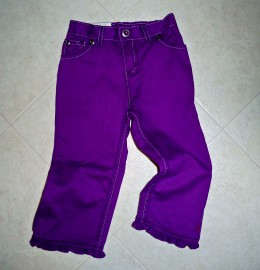 Purple baby denims are ready to go with their tiny ruffled legs.
