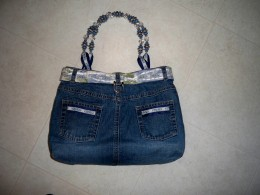 Same denim bag showing embellished pockets.  Lining matches the belt.