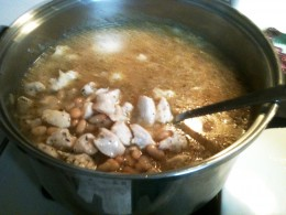 Step 2: Add beans, chicken broth, and spices