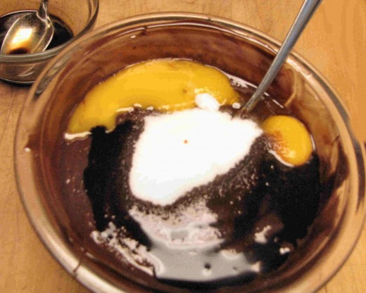 Mix the chocolate with the yolks, remaining sugar, flavorings and almonds if used