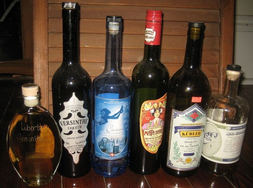 Six bottles of absinthe. Commercially availible in New Orleans, 2009. Left to right, 2 French brands, 1 Swiss, 1 Austrian, 1 Swiss, 1 U.S.A.