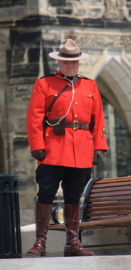 "An officer of the Royal Canadian Mounted Police (a ""Mountie"") standing guard on Parliament Hill in Ottawa, Ontario"