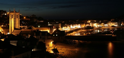 St Ives by night. View out over the harbour, church and town