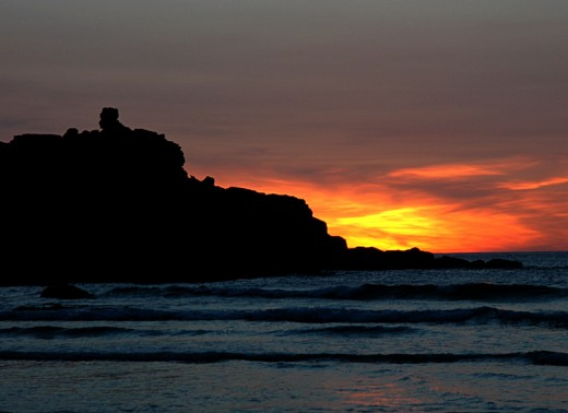 Sunset over Man's Head at the western end of Porthmeor beach