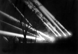"""Mobile anti-aircraft searchlight, used by Engineer Corps. Night view of illumination from 24"""" searchlights. Washington Barracks, D.C."""