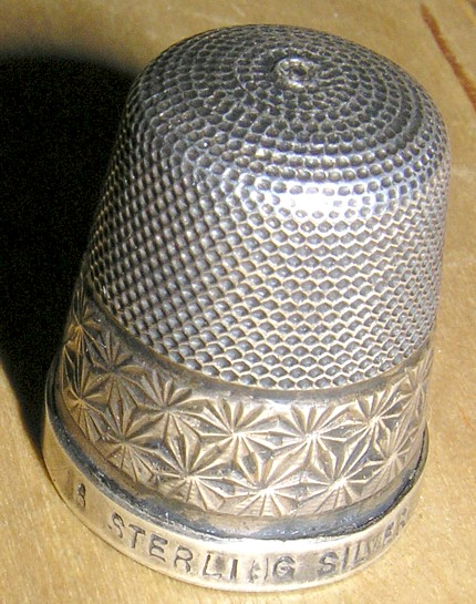 An English silver thimble, unknown vintage.