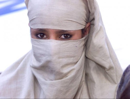 An unknown woman who covered her face, except her pretty eyes