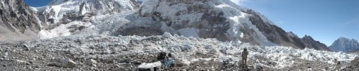 A view of the South Base Camp. The mountain lies ahead, the Khumbu icefall to the left, and a downed helicopter at the base camp are pictured.