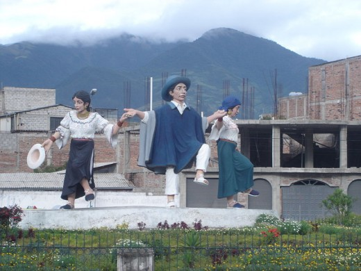 A statue of Otavalo dancers in traditional dress is an expression of pride.