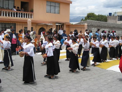 Young Otavalo school girls in traditional dress