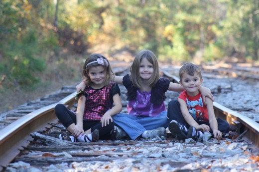 My three kids, sitting on the tracks for this picture