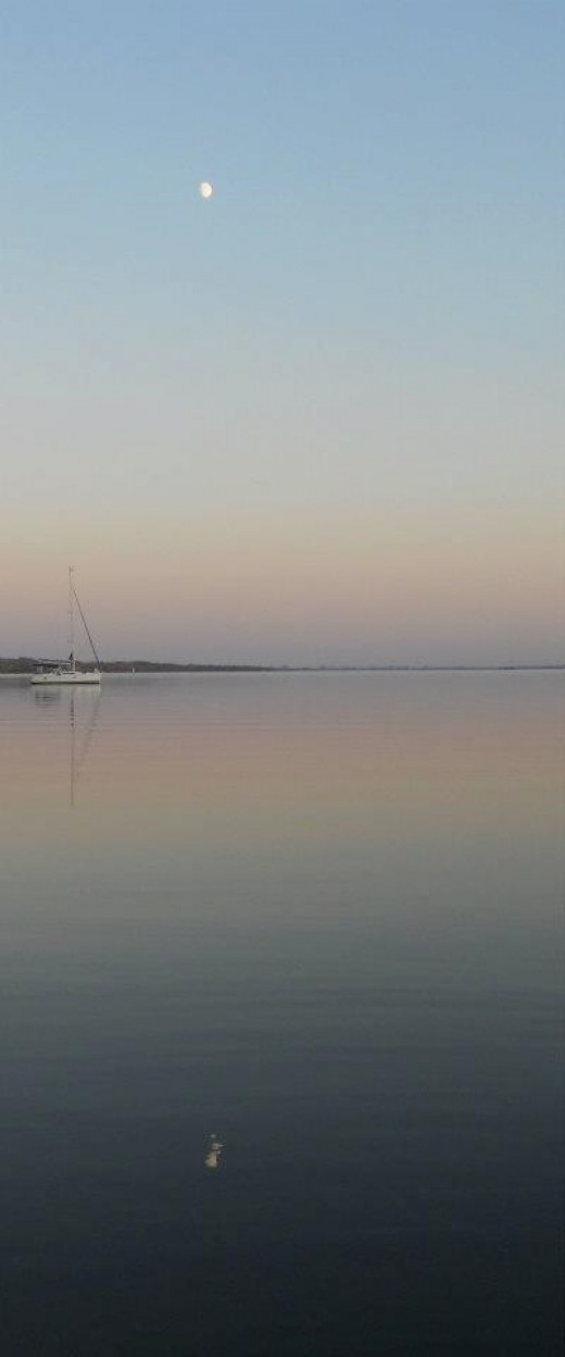 Sailboat on Sunset Waters. Pinney's Point. ©2011 Sarah Haworth.