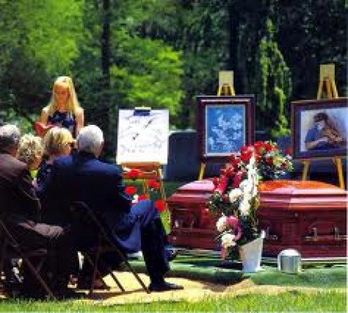 SOME FUNERALS HAVE PICTURES OF THE DECEASED ON DISPLAY AS A GESTURE OF RESPECT FOR THE ONE WHOM HAS PASSED.