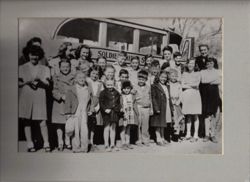 Edna Buffham, her daughter in front of her and her son is the tall boy in the back by the door..  mid 1940's
