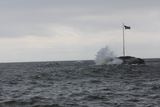 waves crashing on a rock in Long Island sound on a late September day in 2011.