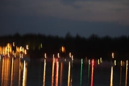 The reflection of the lights of the boats awaiting the fireworks.