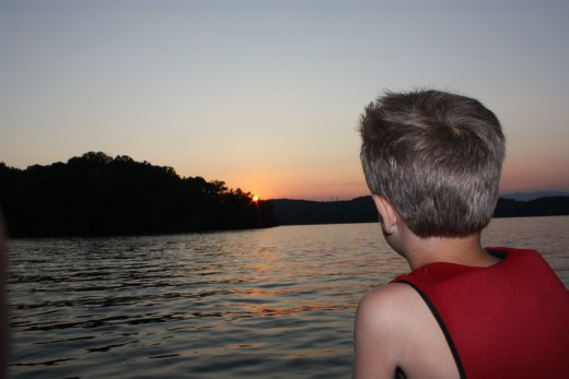 One of our friends son's anticipate's the show as he watches the setting sun.