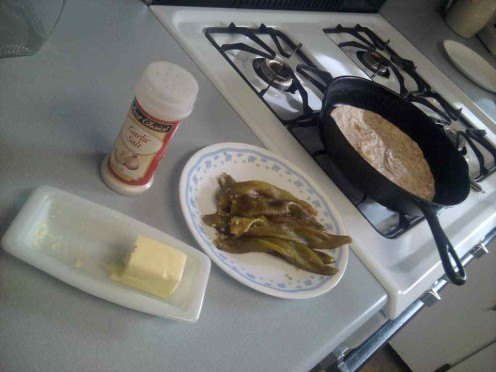 Heat a flour tortilla, spread it with butter, add chiles and garlic salt!  Yummmm!