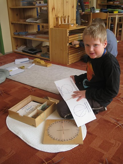 A young child explores angles in the math center at his Montessori school.