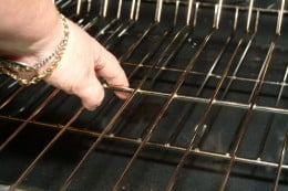 Remove the racks and place them in the soaking formula while you green clean the oven interior surfaces.