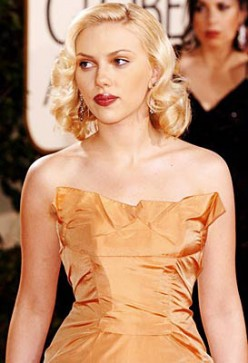 Scarlett Johansson with a hairstyle which sweep and curl to one side with the longer locks curled up to just above the shoulders