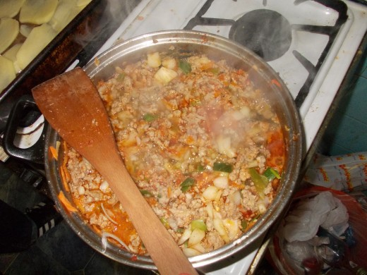 The meat mixture, that is cooking on the fire. It looks delicious, don't it?