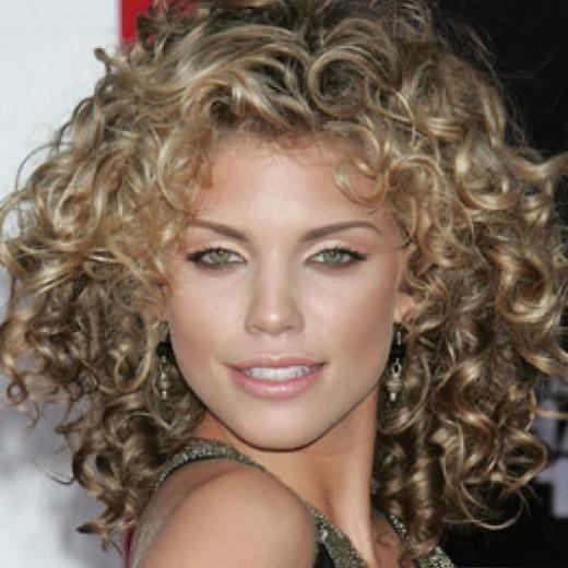 Curly dirty blonde locks frame Annalynne McCord's green eyes beautifully.