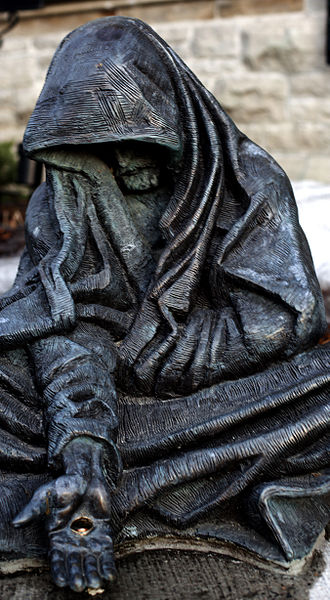 """""""Whatsoever..."""" (2006) by Timothy P. Schmalz. Statue of a beggar on the grounds of St. Andrew's Presbyterian Church at Wellington and Kent Streets in Ottawa, Ontario, Canada"""