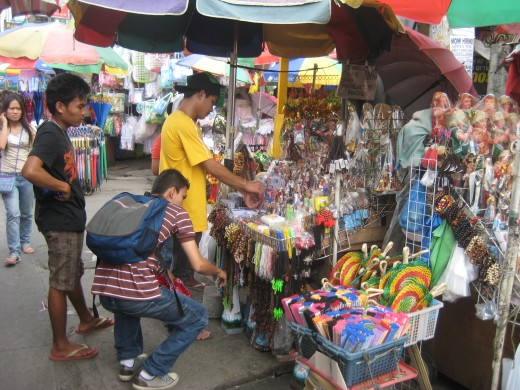 Buyers at a stall beside the Redemptorist church