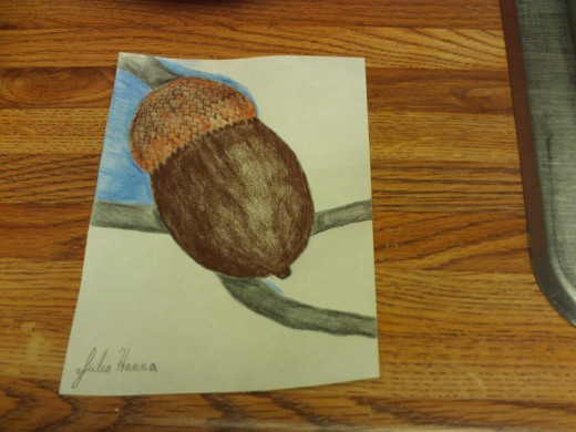 Coloring in the sky blue background surrounding the acorn and the tree.