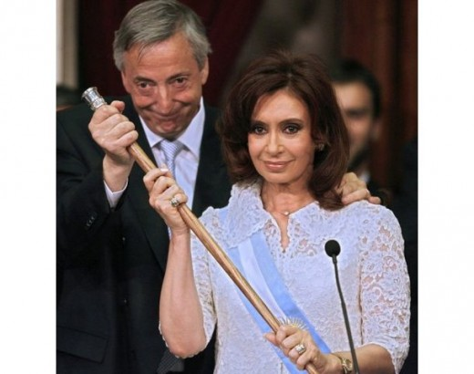 Nestor Kirchner passes the presidential baton to his wife, Cristina, in 2007.