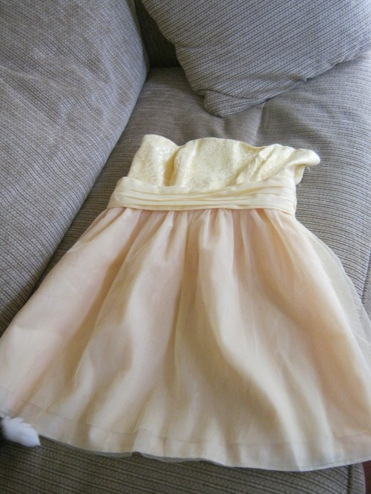 "The yellow.... dress?? The one that makes me look like a ""deranged cupcake from lemon meringue hell""... yep, that one!"