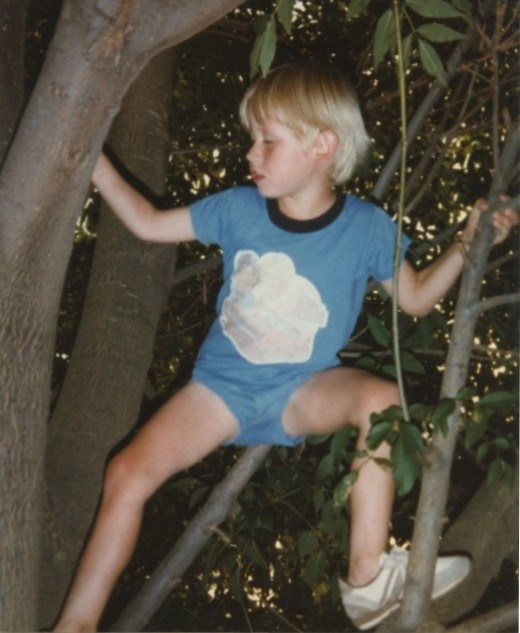 This is my son Jason when he was still our foster child. He loved the tree in our front yard and spent a lot of time there.