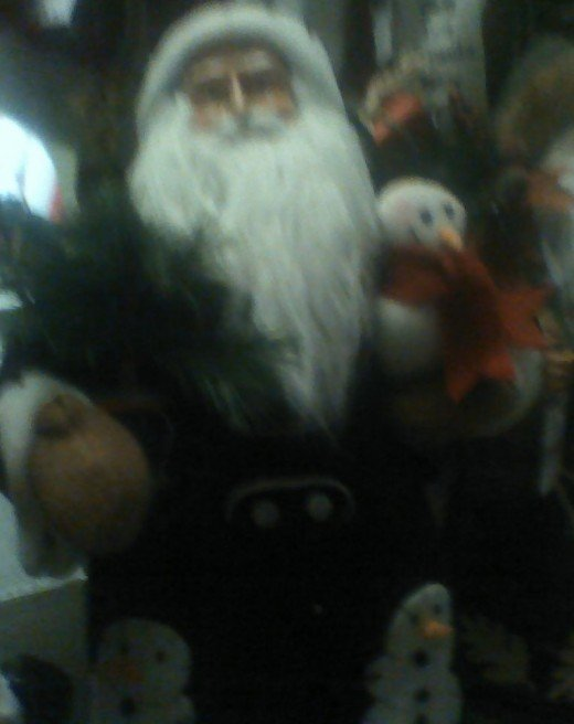 Father Christmas with snow people in his arms