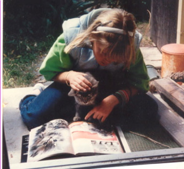 Sarah had a tough time learning to read. She was eager to read this picture book about a cat to this stray cat. The cat was not as eager to be read to, but really had no choice.