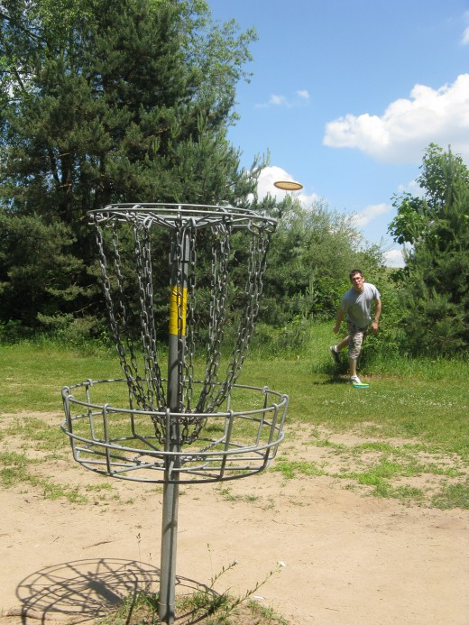 Disc Golf Putting - I like any shot where I can have the blue sky in the background.  The disc really stands out against the sky.