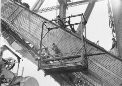 Riggers riveting the red-hot rivets on the lower outside south chord, Sydney Harbour Bridge, 1930-1931