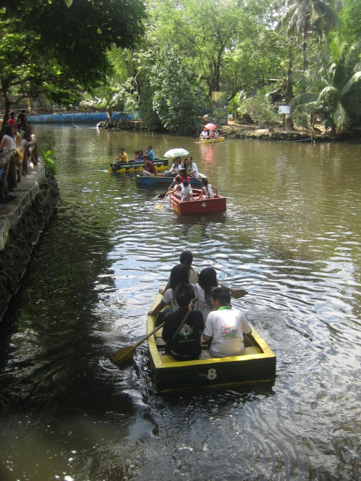 The man-made lake at Manila Zoo with tourists having boat rides