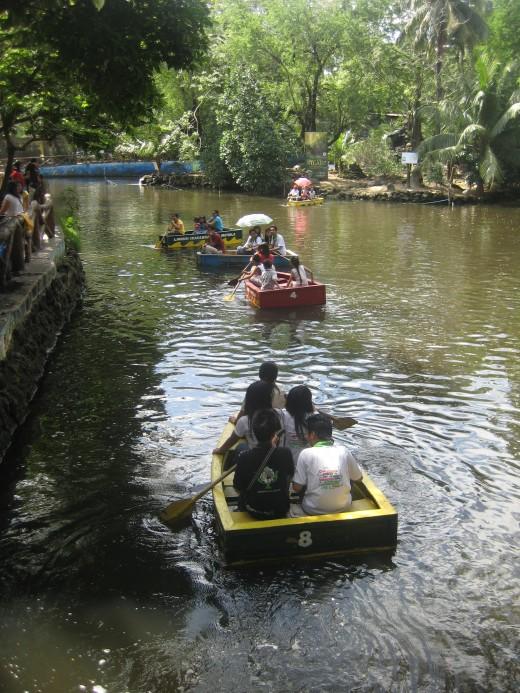 The man-made lake at Manila Zoo with tourists having boat rides