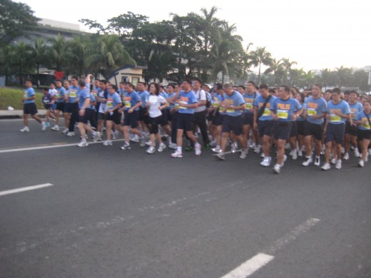 The cadence and chants of organized Manila police participants were mimicked by other runners, including me.