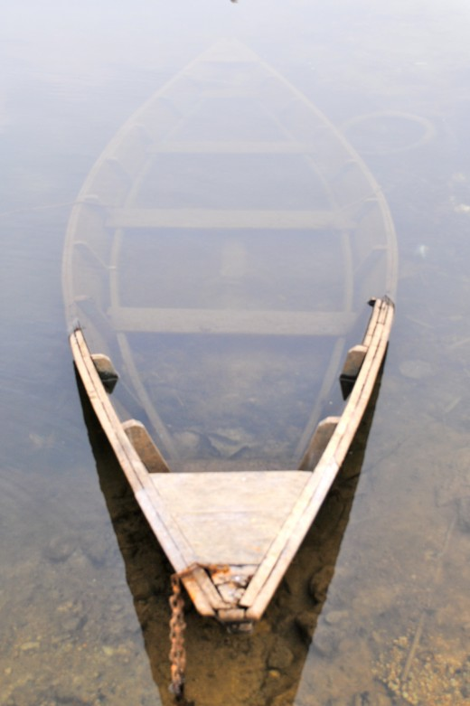 Deserted row boat in Phewa Lake, Pokhara.