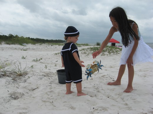 My grandson and niece, crabbing at the Gulf. Photo by Holle Abee.