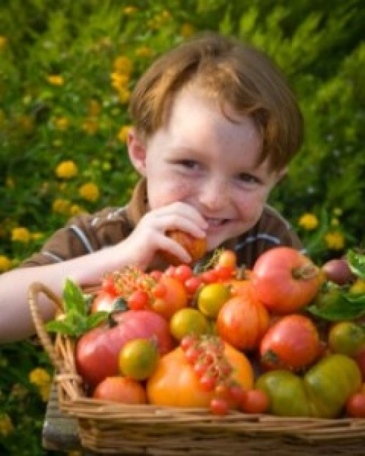 Child with fruits and vegetables