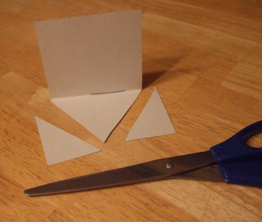 Cut the bottom so that it becomes a triangle.
