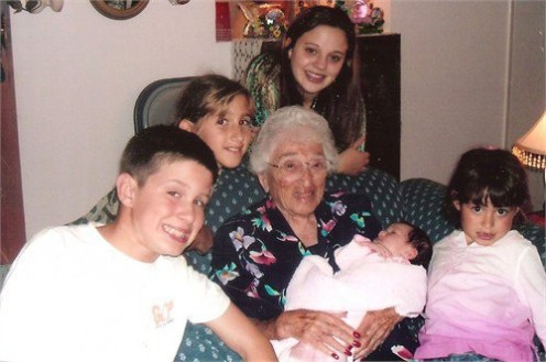 Ruth K. Darling, surrounded by her great-grandchildren at the family Hanukkah party in 2006.
