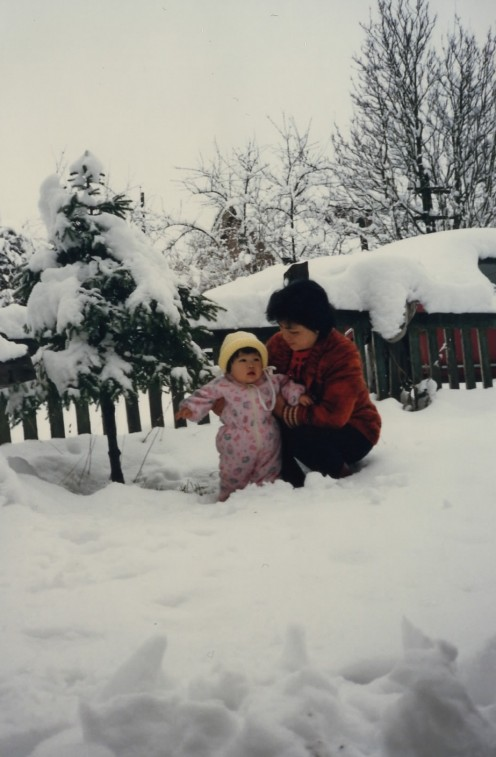 With my mom as a toddler
