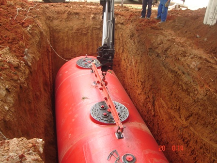 A gasoline storage tank being installed at a gas station.