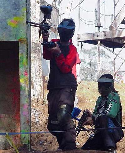 Two boys playing paintball.