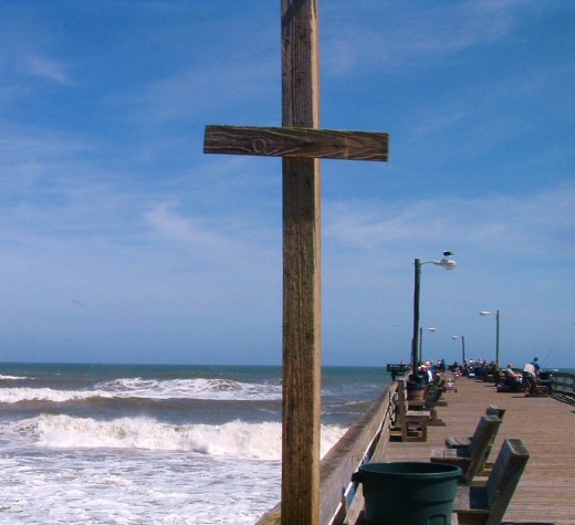 This post was part of the fish cleaning area but I thought it made a stunning cross with the ocean as background.