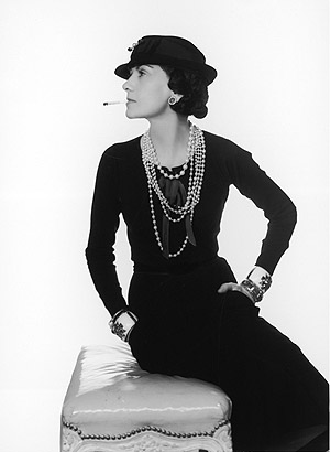 Coco Chanel in trademark ropes of pearls in a 1935 Man Ray portrait. Coco Chanel advocated what she called 'austere luxury', the essence of chic.